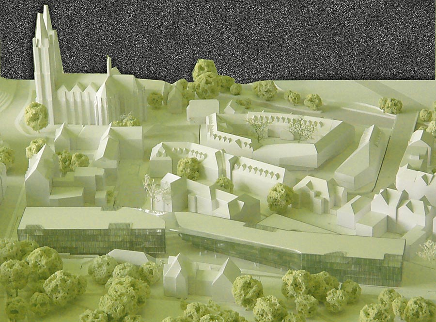 Modell vom Campus Firmaei mit neuer Universitätsbibliothek im Vordergrund präsentiert im Rahmen des Wettbewerbsverfahrens für die neue Bibliothek. Foto und Bearbeitung Hartwig Bambey.